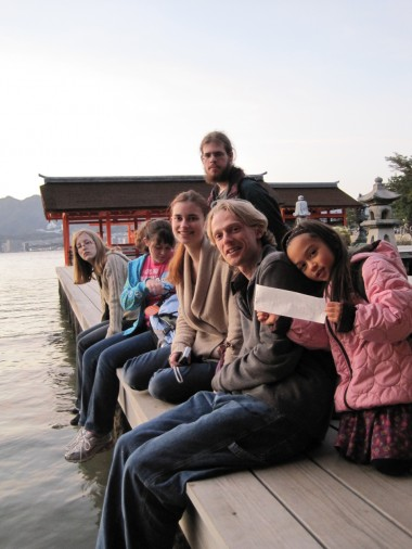 Hiroshima - Miyajima - Six unschoolers/homeschoolers ages 5-25 hanging out at the Miyajima Shrine on the water.