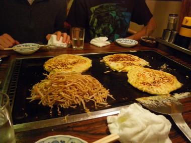 Okonomiyaki finished with Hananh's yaki soba in Kyoto, Japan.