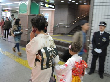 Shichi go san - Modern Japan - Tomoko and Yuni on the move in the Osaka subway system wearing their beautiful kimonos