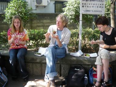 Tako yaki - Becki, Eli, and Rachel eating fried octopus dumplings in Osaka, Kansai, Japan: the capital of tako yaki.