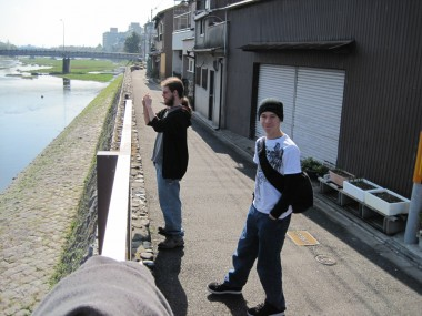 David with Conor taking a photo on the Kamo River, Kyoto, Japan.