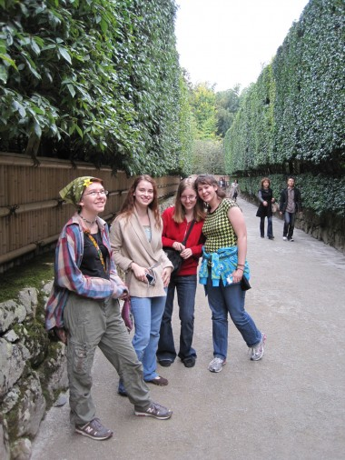 The unschooling/homeschool girls of the Worldschool Travel Tour on the hedged path into the Silver Temple.