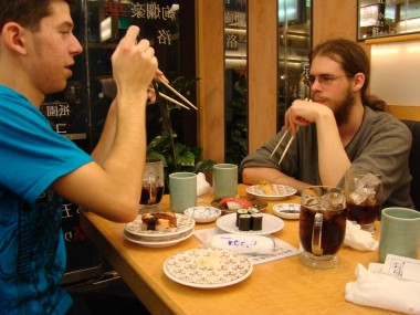 David and Conor trying sushi - even if they didn't end up really liking it.