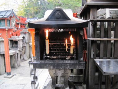 Fushimi Inari Taisha - Candles burning at the top of the mountain next to the ceremony (we were told it was okay to take photos)