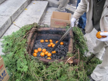 Fushimi Inari Taisha - For some reason they were cooking tangerines this strange fireplace.