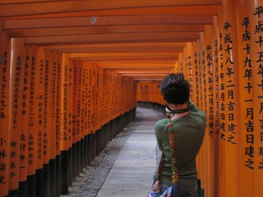 Fushimi Inari Taisha - Rachel taking a shot of the tunnel when no one else is walking down.