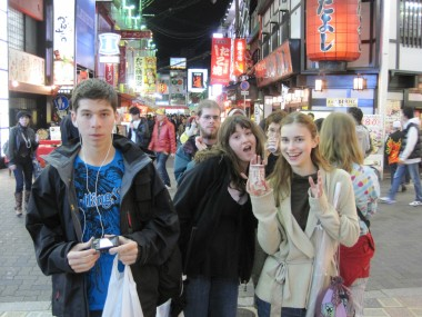 Last year's Worldschool Travel Tour group joking around amidst the shining lights of Osaka's restaurants.
