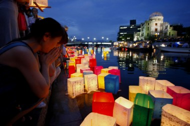 Memorial Service in Hiroshima, Japan with floating lanterns on the river in front of the A-Bomb on the anniversary of the dropping of the atomic bomb.