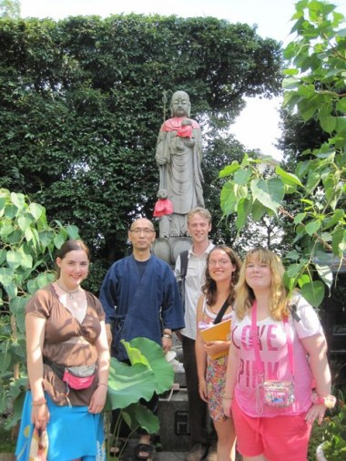 The group in front of a Jizo statue (protector of children and travelers in Japanese Buddhism) with Hattori-san, a Buddhist monk, at his temple, Jikei-ji, in Mikuni, Osaka, where I used to live.