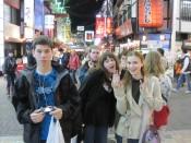 Last year's Worldschool Travel Tour group joking around in amidst the shining lights of Osaka's restaurants.